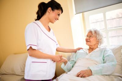 senior woman patient with nurse at private nursing home