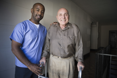 male healthcare worker with elderly man