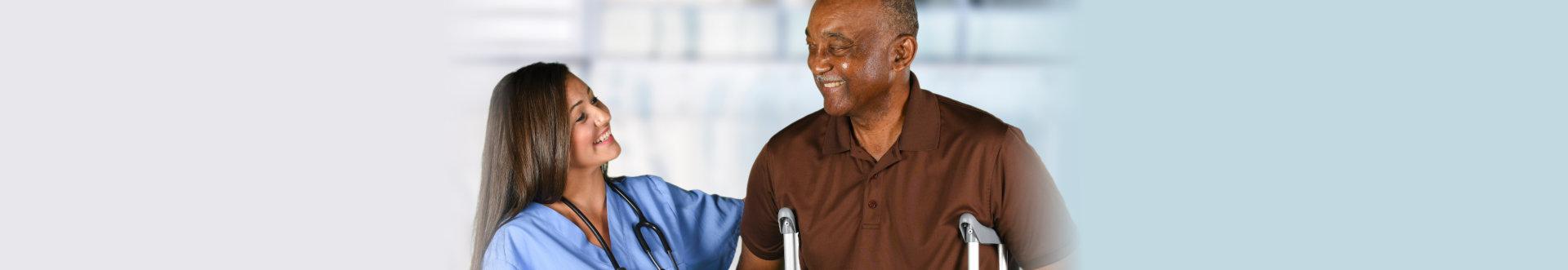 caregiver woman looking at senior man